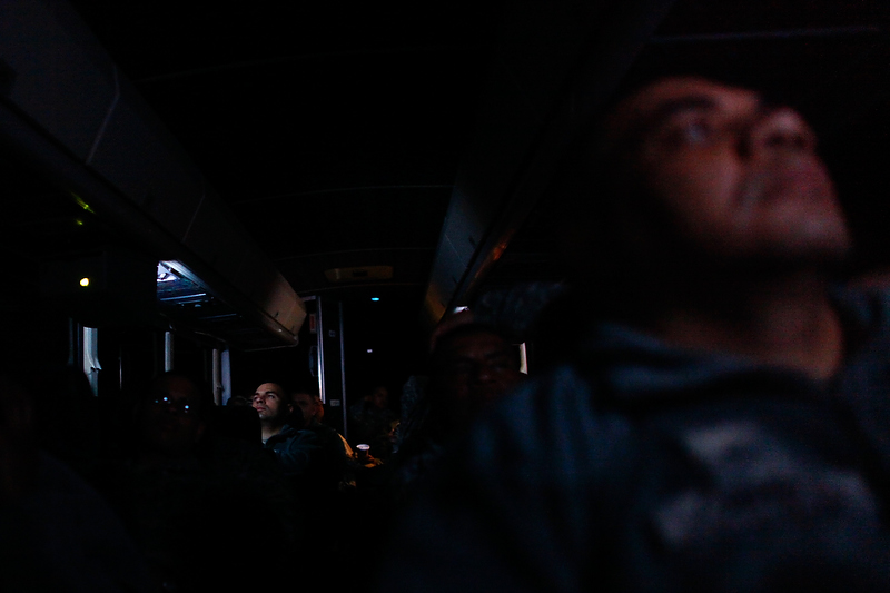 Soldiers watched movies on the charter bus during the bus ride down to Florida.