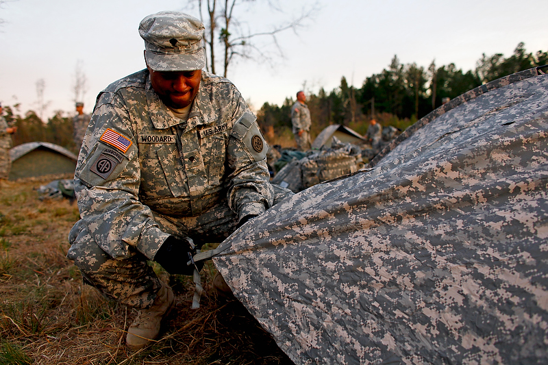Spc. Woodard sets up his tent upon arrival to the training site. This would be his home for the next 12 days.