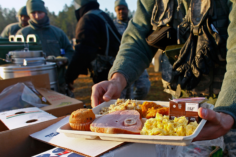 Soldiers are served breakfast just as the sun begins to rise.