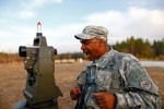 Sgt. 1st Class Suarez screams out data he reads off his gun laying and positioning system.