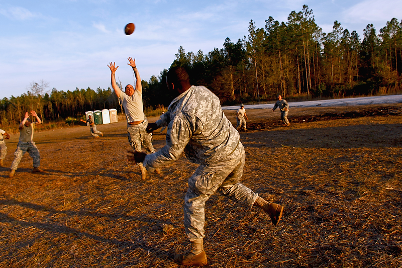 Soldiers organize an ad hoc game of football.
