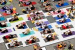 Yoga enthusiasts participate in {quote}Solstice in Times Square{quote} on June 21, 2009.