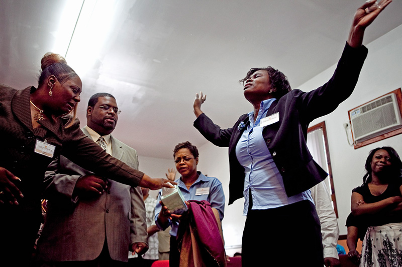 A member of the Harvest Church International in Jamaica, Queens pours her soul in prayer on June 28, 2009.