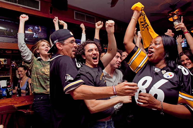 Diehard Steelers fans (from left to right) Rhonda Yantiss, Chris Marasco, Omar Gadalla, all from Manhattan and Terri Shaw, from Staten Island, cheer during a first half Steelers touchdown at Ship of Fools in the Upper East Side, Sept. 10, 2009.