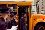 Orthodox Jews board a bus after protesting a hospital's practices on Sept. 16, 2009 in Manhattan.