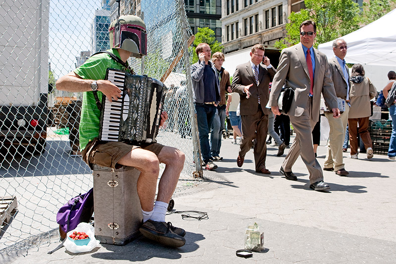 A businessman gives a puzzled look at Nathan Stodola as he plays what he calls the 'Renegade Accordian' in Union Square on June 1, 2009.