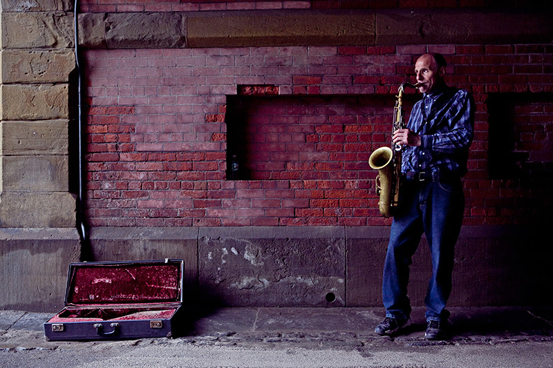 Veniamin Popov plays the sax under a bridge in Central Park on June 24, 2009.