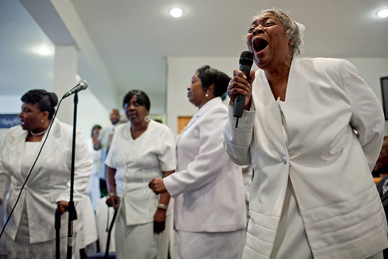 Members of the ministry choir sing a song of praise at Blanche Memorial Baptist Church in Jamaica, Queens, Feb. 7, 2010.