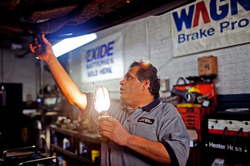Frank Vozos, president of Astoria Auto Repair, inspects a damaged car frame caused by potholes, Jan. 14, 2010.