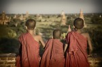 Young monks at sunset