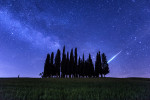 Meteor and Milky Way above Tuscany