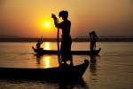 Fisherman at sunset in Mandalay, Myanmar