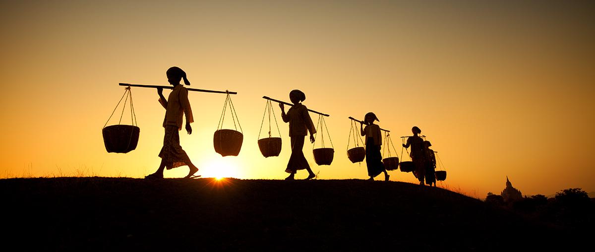 Workers by their village in Bagan, Burma