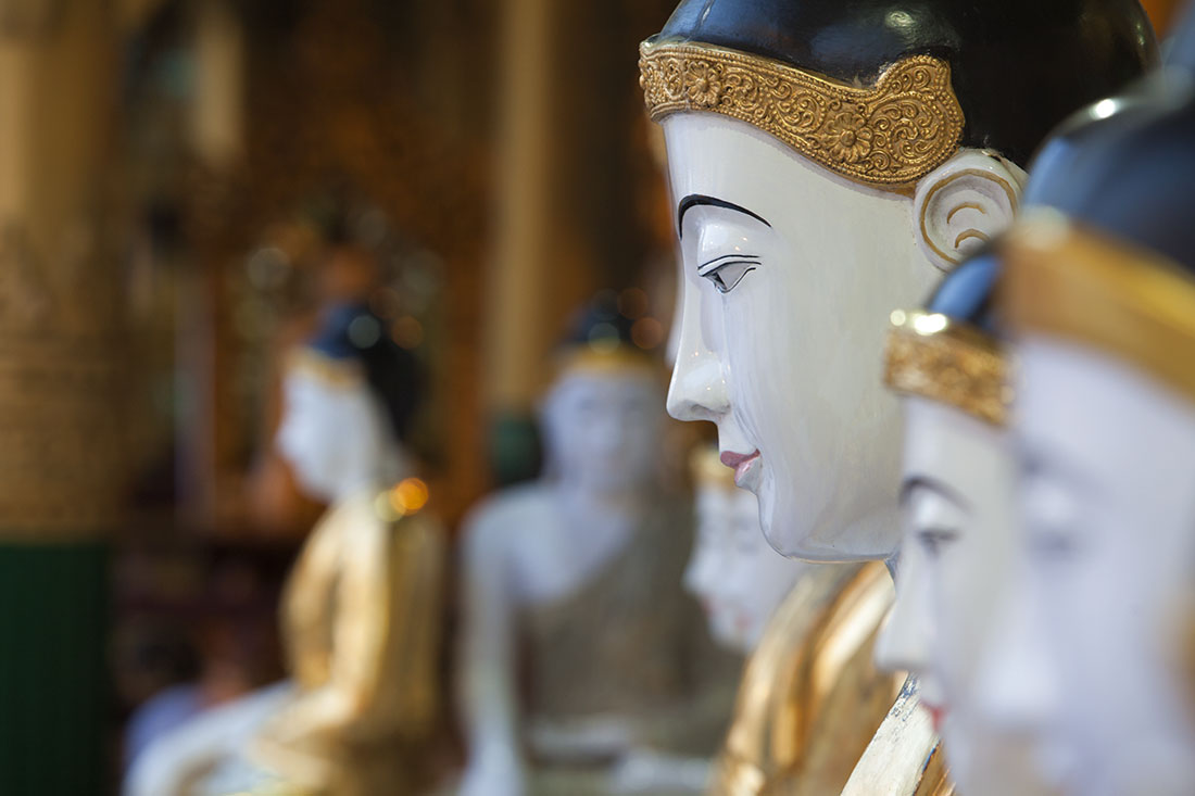Buddhas inside the Shwedagon Pagoda, Yangon
