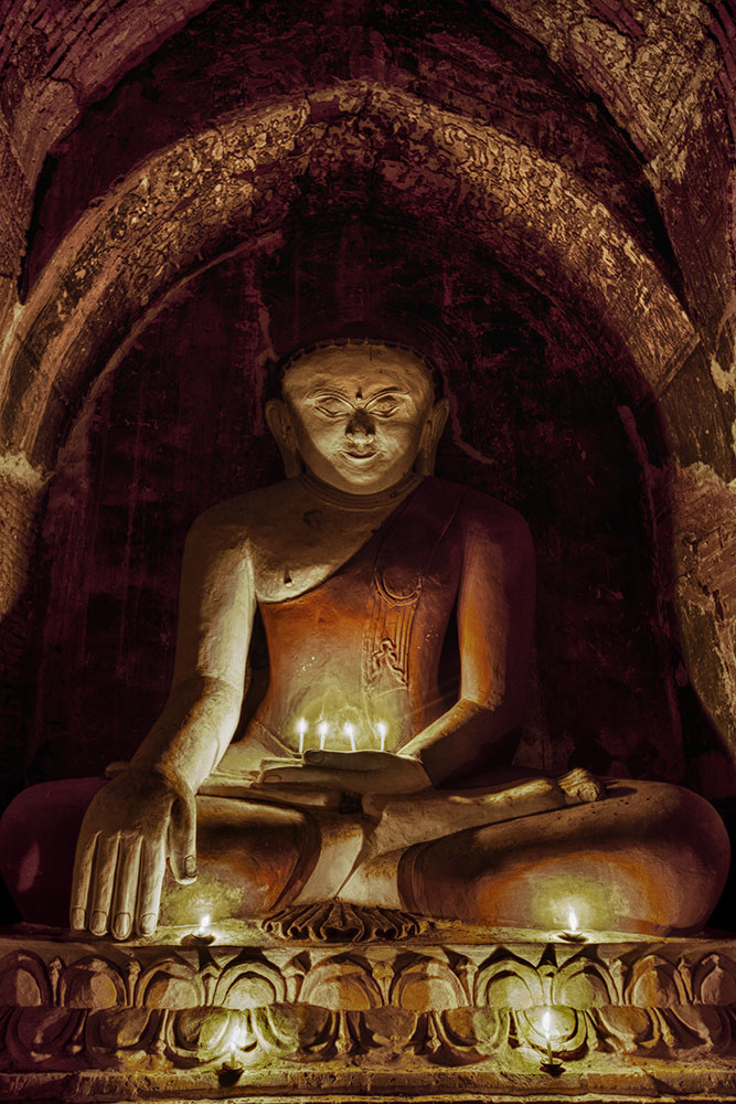 Buddha with candles in Bagan