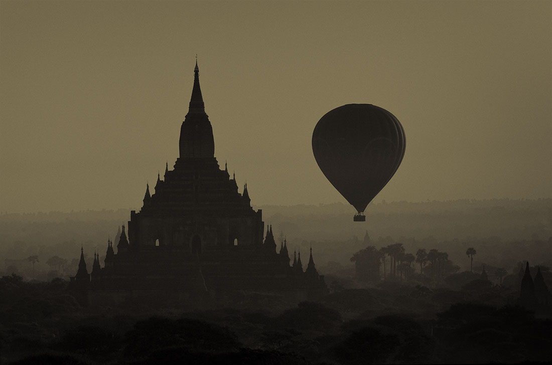 Hot air balloon floating across Bagan