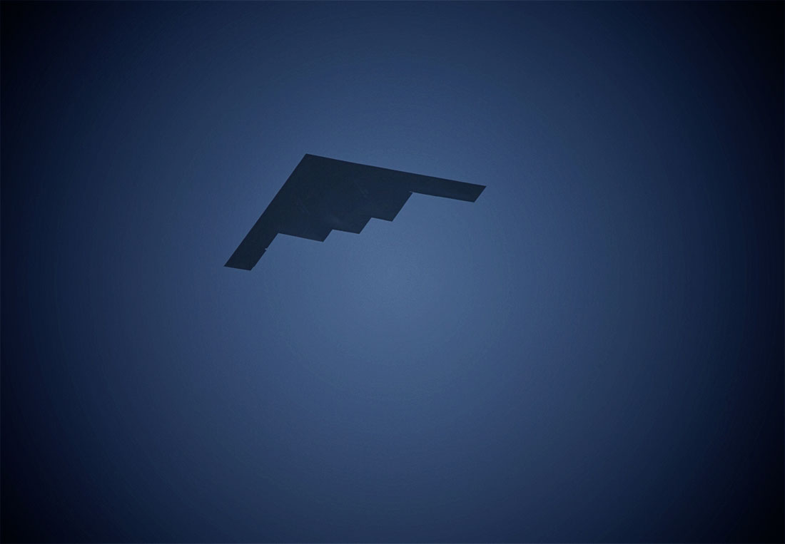 The Stealth Bomber flying over the sand dunes