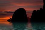 Holly climbing rocks at sunset