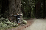 My baby hugging a giant redwood