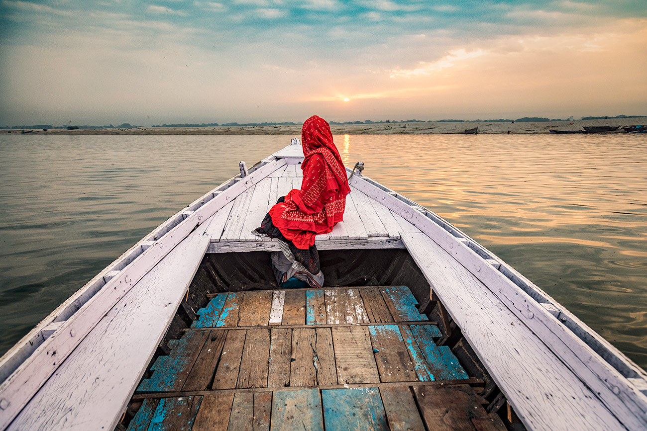 Lone girl on the Ganges in Varinasi, India
