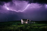 Lighting storm over abandoned home