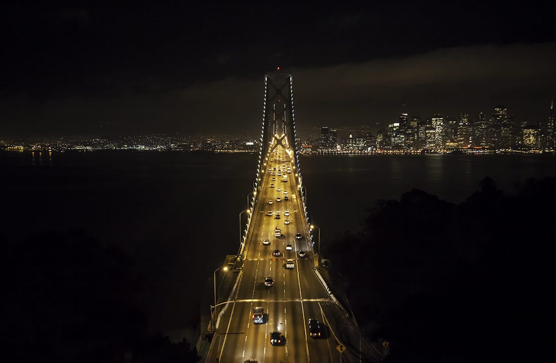above the Oakland Bay Bridge at night