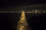 above the Oakland Bay Bridge at night