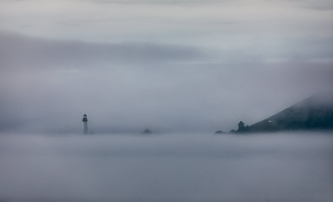 Yaquina Lighthouse in fog on the Oregon Coast