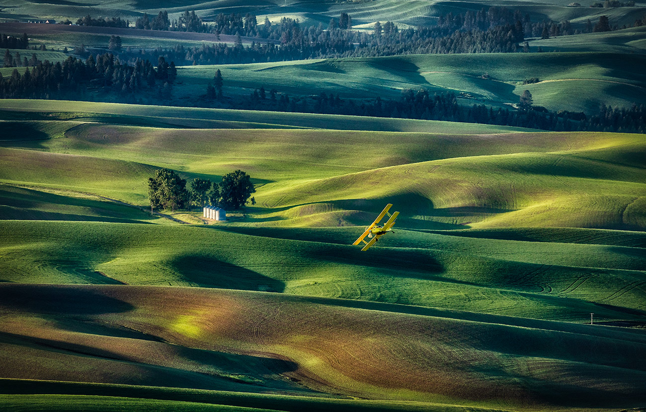 Crop duster at sunrise by Steptoe Butte