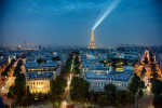 The Eiffel Tower and Paris skyline after dark