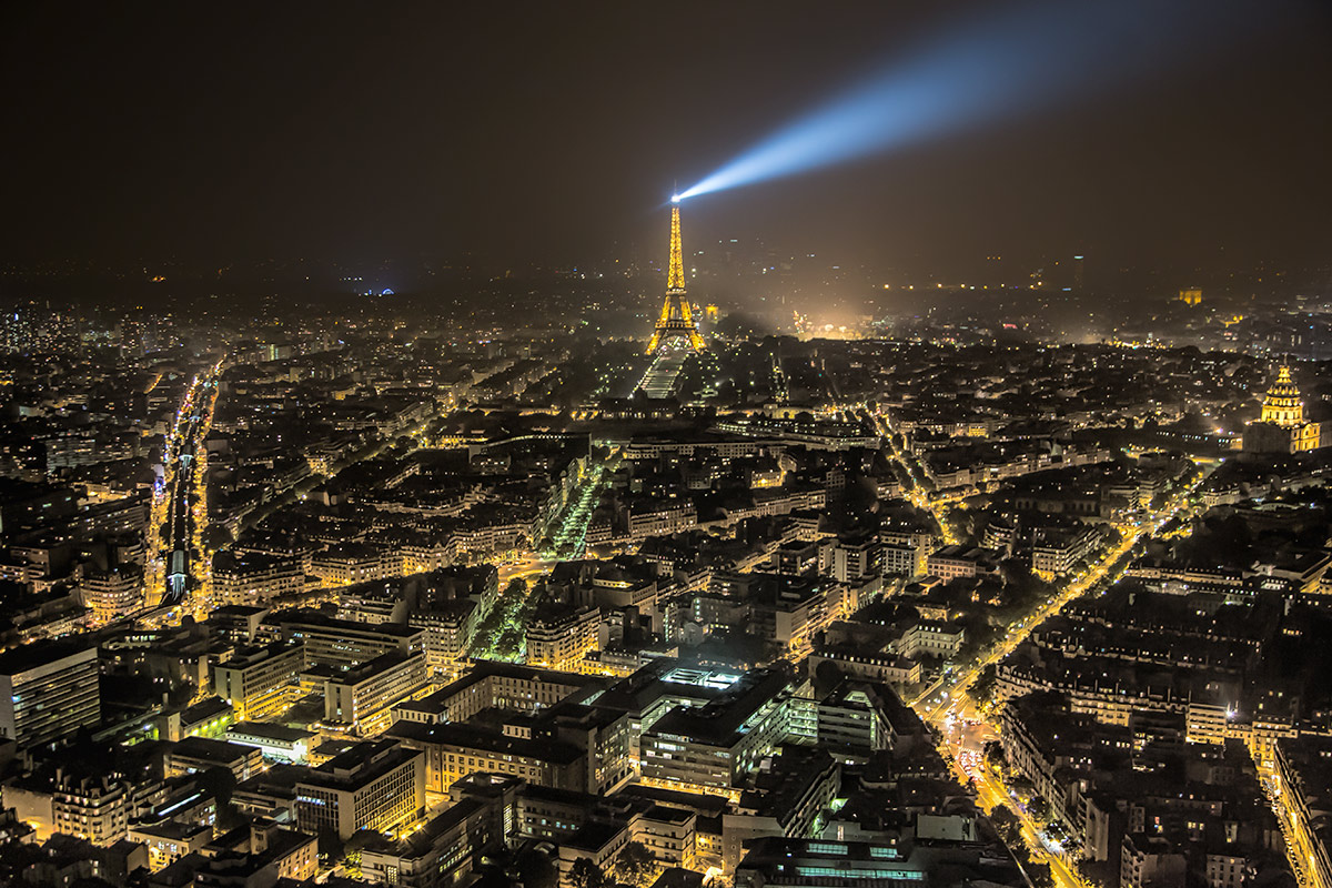 The Eiffel Tower and Paris skyline after dark