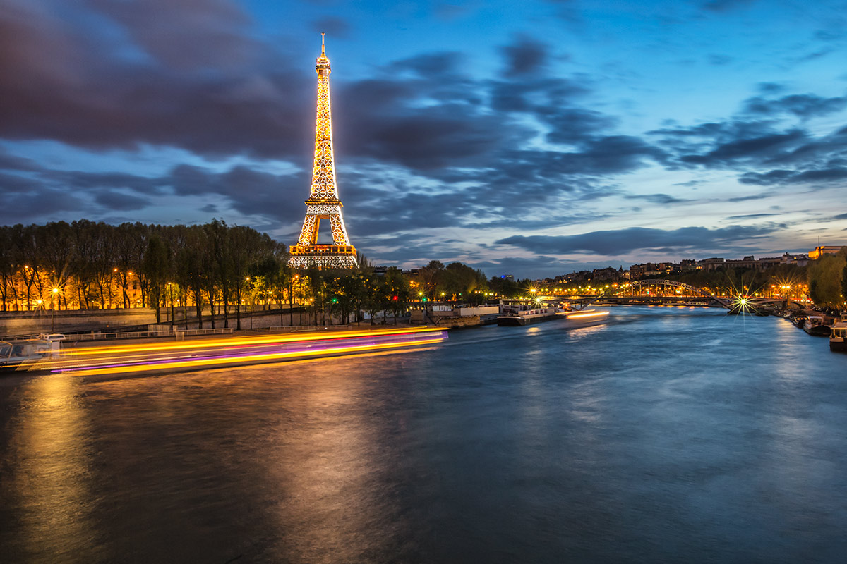 The Eiffel Tower and Seine River after dark