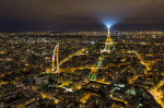 The amazing Eiffel Tower after dark from above