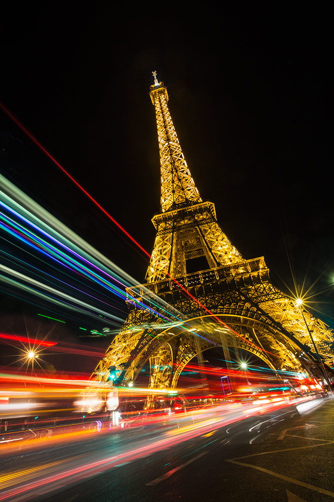 Car trails by the Eiffel Tower, Paris, France