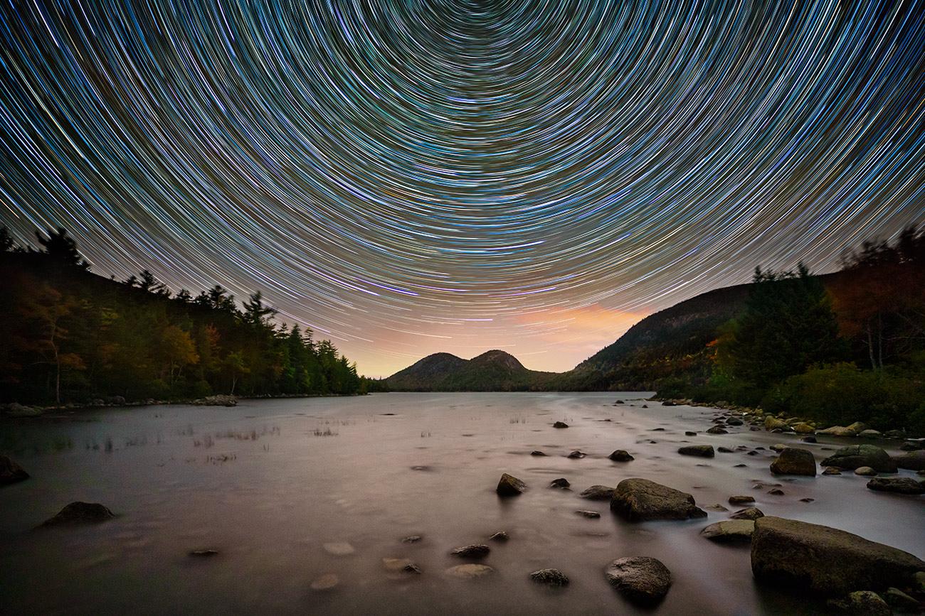 Star trails over Jordan Pond in Acadia