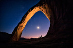 Holly under Corona Arch in Arches National Park