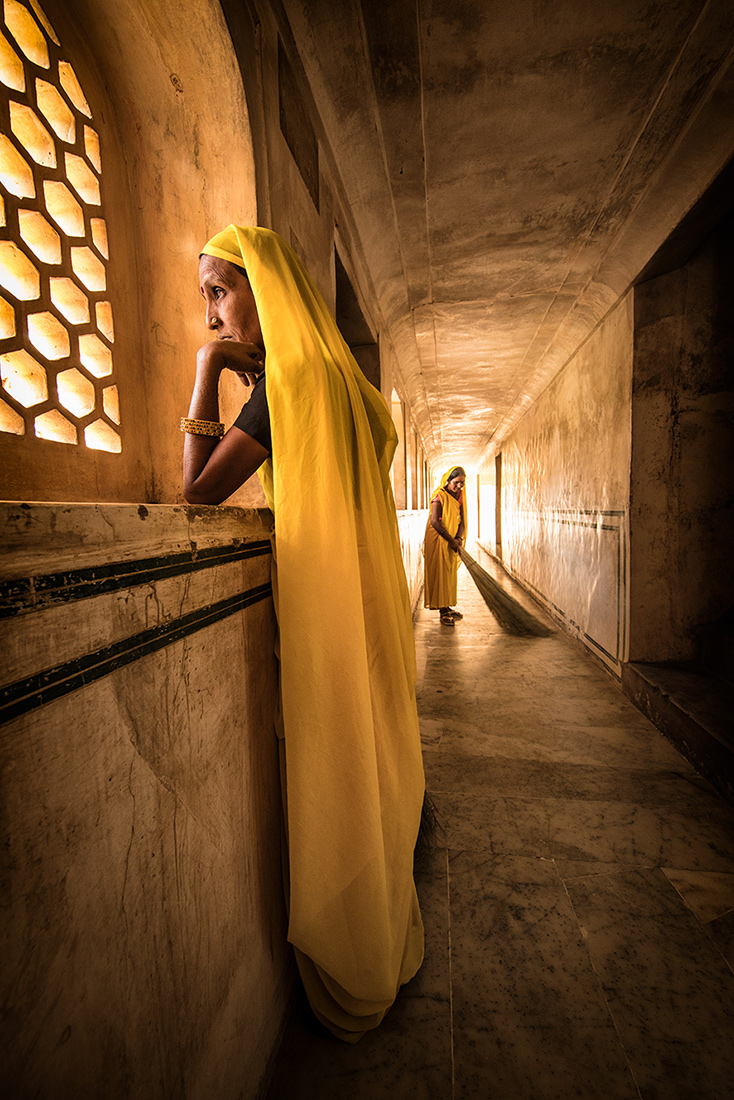 The Yellow sweepers of Amber Fort in Jaipur, India