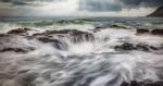 Waves crashing into Thors Well on the Oregon Coast