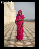 Woman in red by the Taj Mahal    Vogue Italia