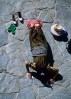 well-to-do pilgrim prostating outside Jokhang Temple