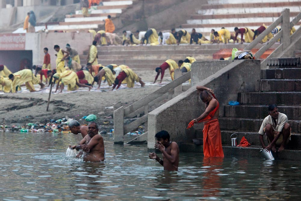 Morning yoga and ablutions on the Ganges