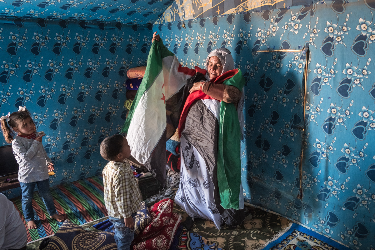 Tifariti. RASD, Saharawi administrated territories of Western Sahara. A family from the now occupied territories, had decided to come back in the RASD near Tifariti after 3 decades in the refugee camps. The matriarch showing off the flag