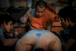 Sak Yant tattoo in Wat Bang Phra temple.