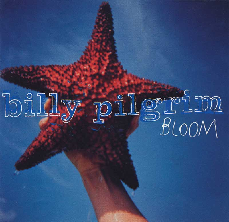 Billy Pilgrim Bloom CD Cover Atlantic Records.  Jennifer Roddie, Art Direction, L.M.A.I. Design.  Man holding Starfish against blue sky ag_0000_1225 Color Rights Managed Image Copyright © 1994 Ann Giordano All Rights Reserved.  For reproduction rights and license fees, please contact licensing at anngiordano.com