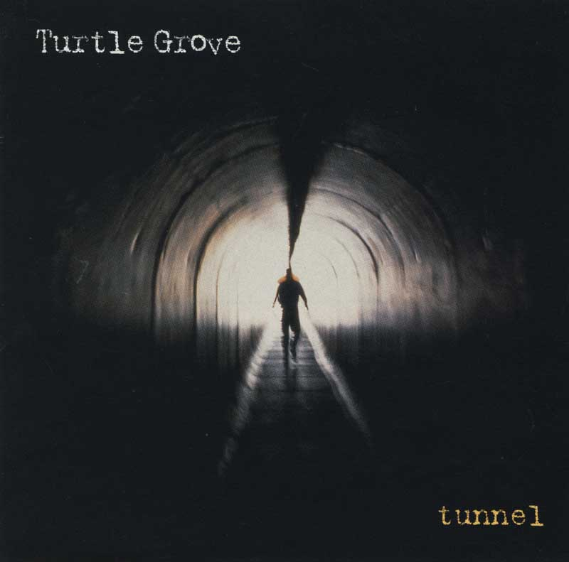 Turtle Grove, Tunnel, CD Cover, Francesca Restrepo, Art Direction.   Man walking down tunnel towards light  ag_0002_4092  Color Rights Managed Image Copyright © 1997 Ann Giordano  All Rights Reserved.  For reproduction rights and license fees, please contact licensing at anngiordano.com