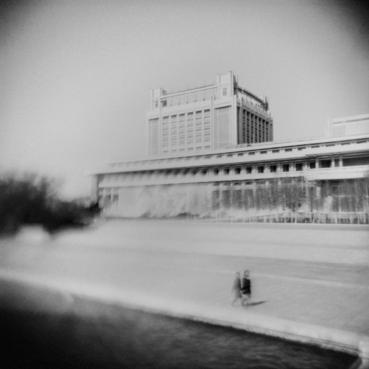 Two children walk along an empty street in Pyongyang, the capital of North Korea.