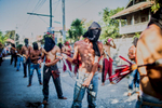 Penitents flay themselves on the streets of Cutud during Holy Week in the Philippines.