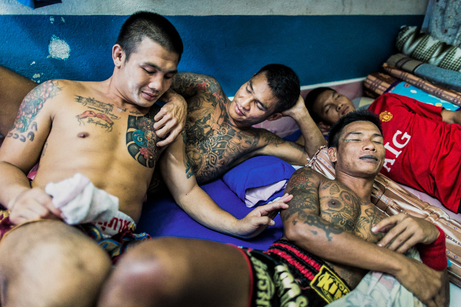 A quiet moment between inmates in Klong Prem prison on the outskirts of Bangkok, Thailand.