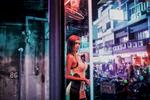 A neon-lit portrait of Yaya, a transgender prostitute in Pattaya, Thailand.