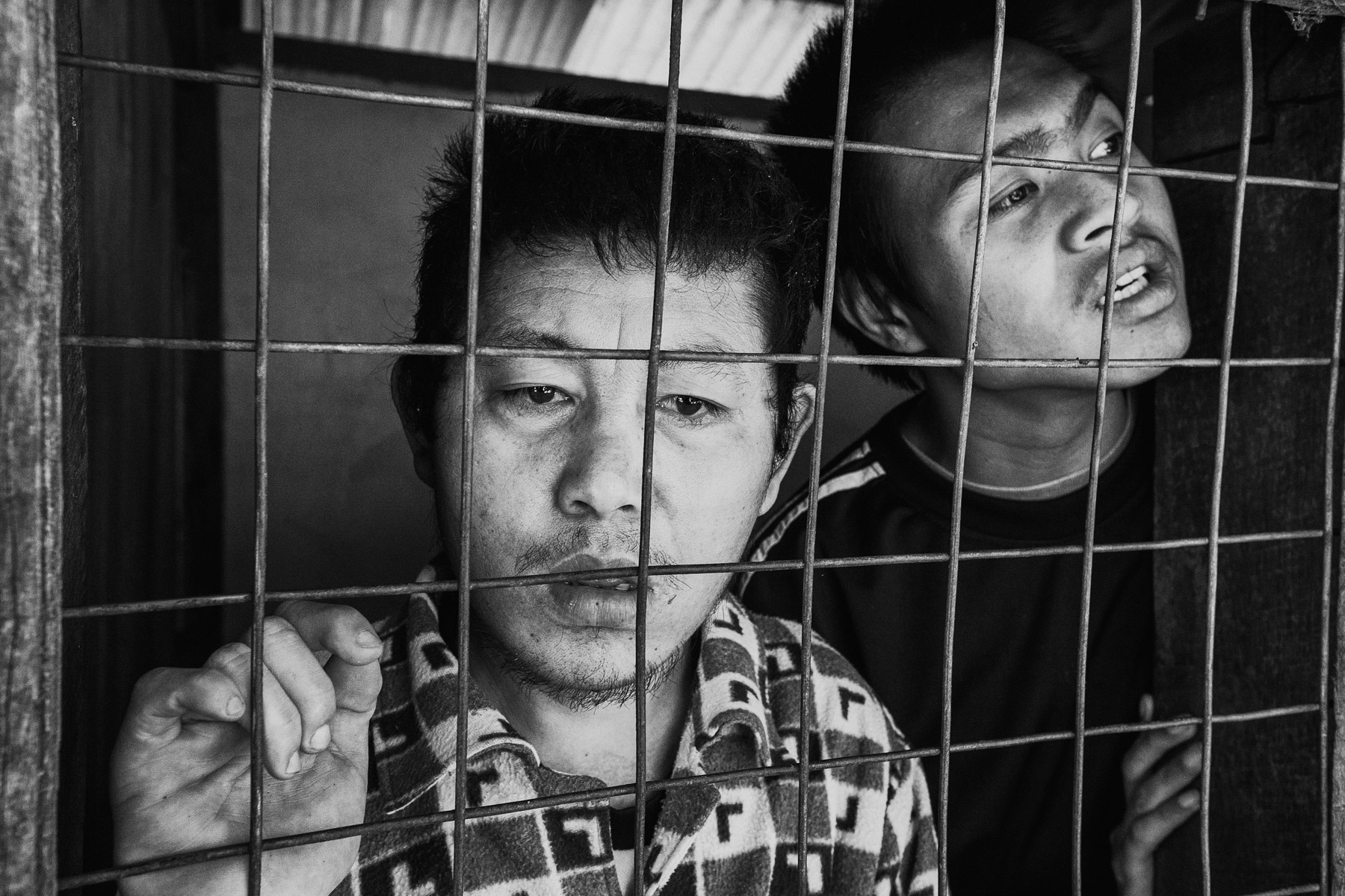 Two mentally disabled men are kept behind bars at a facility in northern Shan State, Myanmar.
